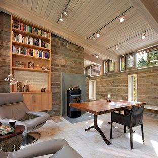 Idée de décoration pour un grand bureau design avec un poêle à bois, un bureau indépendant, un sol beige, un mur beige et un sol en travertin.