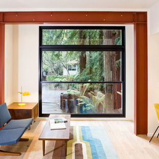 Design ideas for a medium sized contemporary study in San Francisco with light hardwood flooring and a built-in desk.