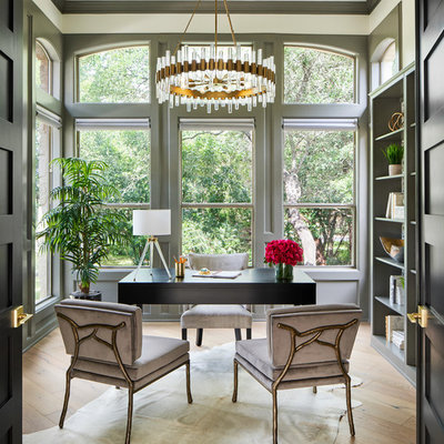 Home office library - mid-sized transitional freestanding desk light wood floor and gray floor home office library idea in Austin with gray walls