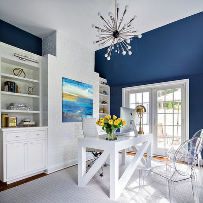 Study room - transitional freestanding desk study room idea in New York with blue walls