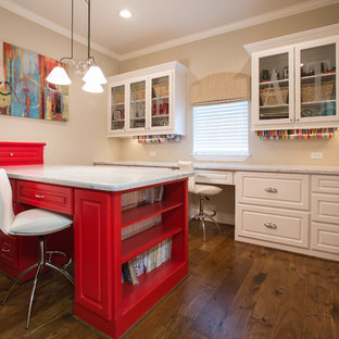 Craft room - traditional built-in desk craft room idea in Houston