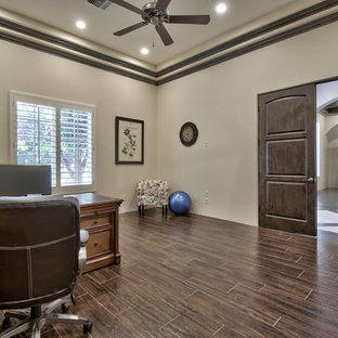 Study room - huge traditional freestanding desk dark wood floor and brown floor study room idea in Phoenix with beige walls and no fireplace