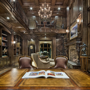 Inspiration for a huge mediterranean freestanding desk study room remodel in Austin with a standard fireplace