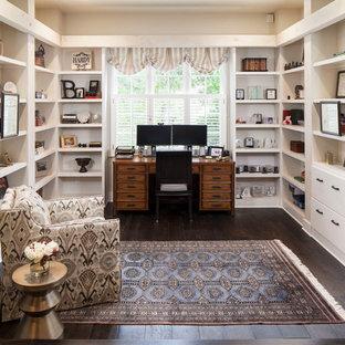 Elegant dark wood floor home office photo in Austin with beige walls
