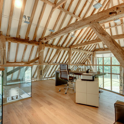 Inspiration for a country freestanding desk light wood floor study room remodel in Other with white walls