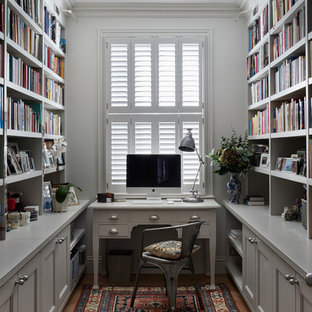Design ideas for a medium sized classic home office and library in London with grey walls, light hardwood flooring, a freestanding desk, beige floors and a reading nook.
