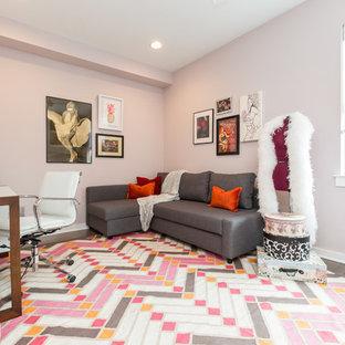 Design ideas for a medium sized modern craft room in Philadelphia with pink walls, medium hardwood flooring, a freestanding desk and pink floors.