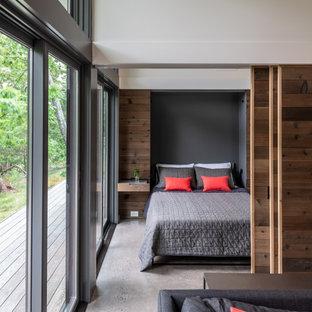 Ejemplo de despacho minimalista, pequeño, con suelo de cemento, marco de chimenea de hormigón y suelo gris