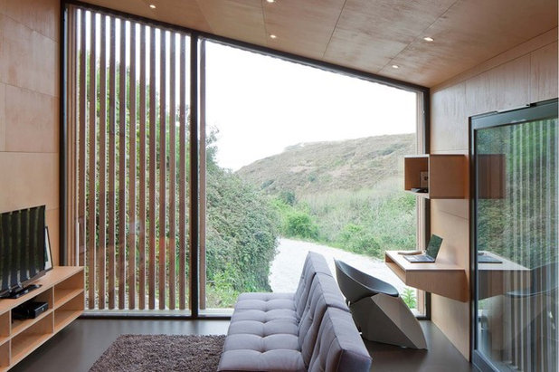 Contemporary Home Office & Library by Ecospace® Ltd.