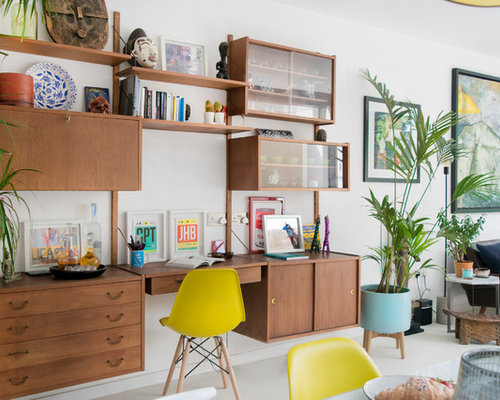 midcentury modern built in desk gray floor home office photo in london with white walls