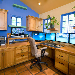 Design ideas for an eclectic study in Santa Barbara with blue walls, terracotta flooring and a built-in desk.
