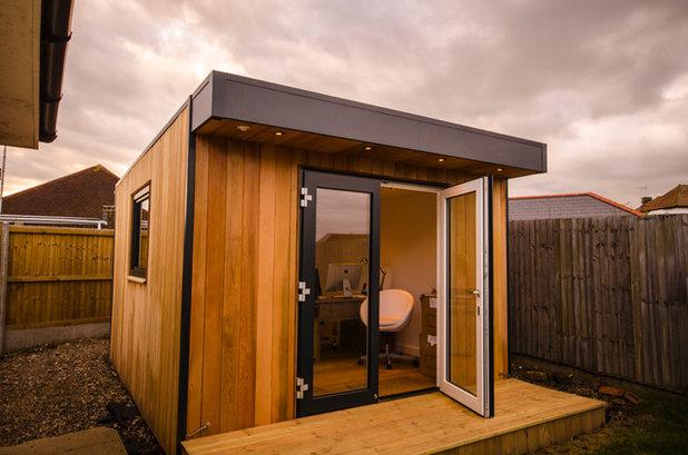 Contemporary Home Office & Library by eDEN Garden Rooms