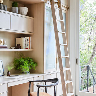 Inspiration for a transitional built-in desk light wood floor and beige floor study room remodel in New York