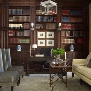 Example of a mid-sized classic freestanding desk dark wood floor study room design in Houston