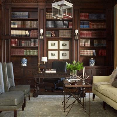 Example of a mid-sized classic freestanding desk dark wood floor study room design in Houston