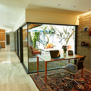 Inspiration for a small 1950s freestanding desk limestone floor study room remodel in Phoenix