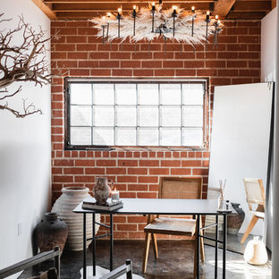 Home studio - small industrial freestanding desk concrete floor and gray floor home studio idea in Other with white walls and no fireplace