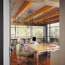 Industrial Home Office by Thomas Roszak Architecture, LLC