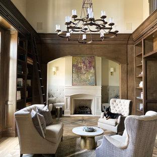 オーランドの大きいトランジショナルスタイルのおしゃれなホームオフィス・書斎 (ライブラリー、ベージュの壁、磁器タイルの床、標準型暖炉、石材の暖炉まわり、マルチカラーの床) の写真