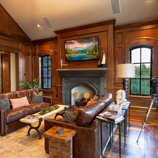 Example of a large mountain style freestanding desk medium tone wood floor study room design in Denver