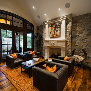 Study room - large rustic freestanding desk medium tone wood floor and brown floor study room idea in Denver with white walls, a standard fireplace and a stone fireplace
