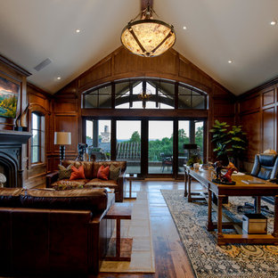 Inspiration for a large rustic freestanding desk medium tone wood floor and brown floor study room remodel in Denver with brown walls, a standard fireplace and a wood fireplace surround