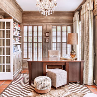 Classic home office and library in Chicago with terracotta flooring and a freestanding desk.