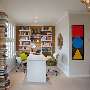 Design ideas for a contemporary study in Hampshire with grey walls, a freestanding desk and beige floors.