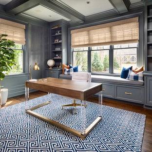 Study room - coastal freestanding desk dark wood floor study room idea in New York with gray walls and no fireplace