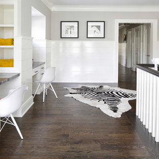 Inspiration for a transitional built-in desk dark wood floor study room remodel in New York with gray walls