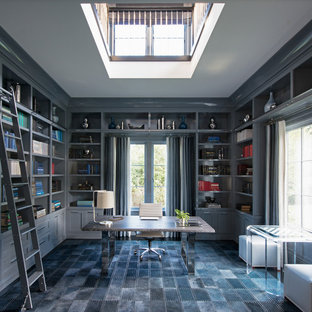 Transitional freestanding desk carpeted and gray floor home office library photo in New York with gray walls and no fireplace