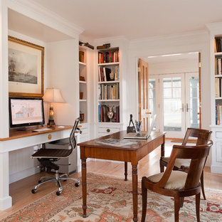 Elegant home office photo in New York with white walls