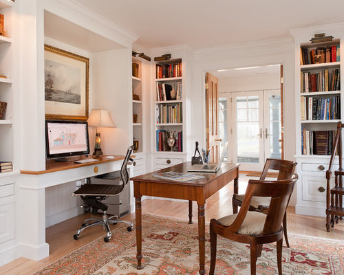 Elegant home office photo in New York with a built-in desk and white