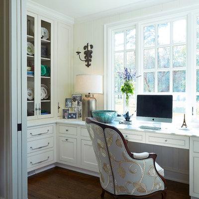 Mid-sized elegant built-in desk dark wood floor home office photo in Birmingham with white walls