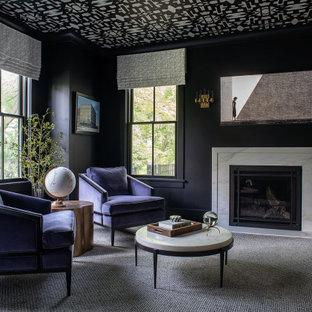 Imagen de despacho clásico renovado con paredes negras, todas las chimeneas y escritorio independiente