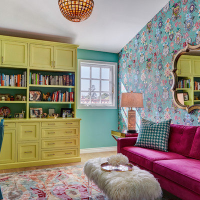 Home office library - eclectic freestanding desk home office library idea in Los Angeles with multicolored walls