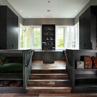 Inspiration for a large contemporary built-in desk medium tone wood floor home office remodel in Grand Rapids with gray walls
