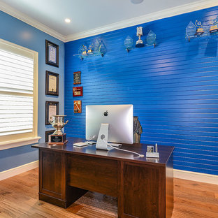 Mid-sized transitional freestanding desk light wood floor home office photo in Tampa with blue walls
