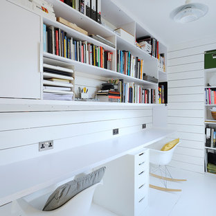 Design ideas for a scandinavian home office and library in Other with white walls, a built-in desk and white floors.