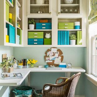 На фото: кабинет среднего размера в стиле современная классика с местом для рукоделия, синими стенами, встроенным рабочим столом и темным паркетным полом без камина