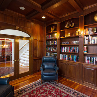 Inspiration for a medium sized traditional home office and library in Raleigh with medium hardwood flooring, no fireplace, a freestanding desk, a reading nook and brown walls.