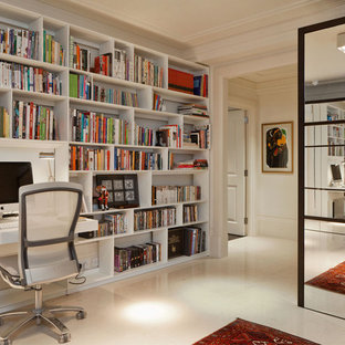 Inspiration for a contemporary built-in desk beige floor study room remodel in London with white walls