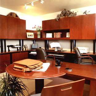 Example of a trendy home office design in Denver