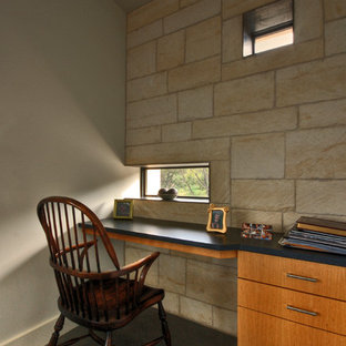 Inspiration for a contemporary concrete floor home office remodel in Austin