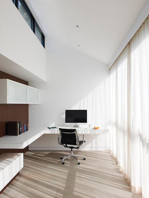 Example Of A Minimalist Built In Desk Study Room Design In New York With  White