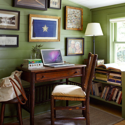 Inspiration for a country freestanding desk light wood floor home office remodel in Austin with green walls