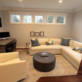 Ejemplo de despacho tradicional renovado, de tamaño medio, con paredes grises, suelo de madera en tonos medios, escritorio independiente y suelo rojo