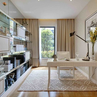 Large freestanding desk carpeted study room photo in Other with beige walls and no fireplace