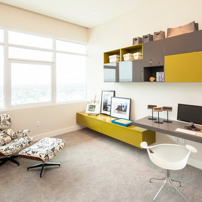 Inspiration for a contemporary built-in desk carpeted and gray floor home office remodel in Los Angeles with beige walls