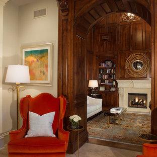 アトランタの中サイズのトランジショナルスタイルのおしゃれなアトリエ・スタジオ (茶色い壁、無垢フローリング、標準型暖炉、石材の暖炉まわり、自立型机、茶色い床) の写真